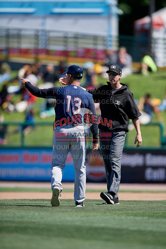 Scranton/Wilkes-Barre RailRiders manager Al Pedrique (13) argues a call with umpire Alex Tosi during a game against the Rochester Red Wings on June 7, 2017 at Frontier Field in Rochester, New York.  Scranton defeated Rochester 5-1.  (Mike Janes/Four Seam Images)