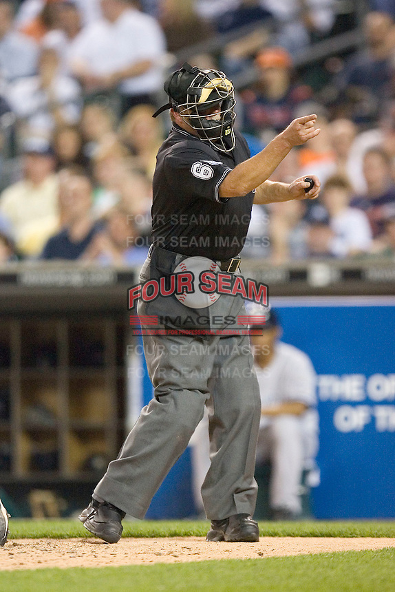 Home plate umpire Jim Joyce makes a strike call in an American League game between the New York Yankees and the Detroit Tigers at Comerica Park April 27, 2009 in Detroit, Michigan.  Photo by Brian Westerholt / Four Seam Images