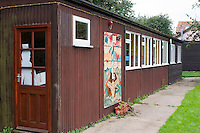 Classrooms building for the youngest, 6-8 year olds, Summerhill School, Leiston, Suffolk. The school was founded by A.S.Neill in 1921 and is run on democratic lines with each person, adult or child, having an equal say.  You don't have to go to lessons if you don't want to but could play all day.  It gets above average GCSE exam results.