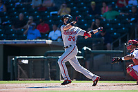 Salt River Rafters shortstop Carter Kieboom (24), of the Washington Nationals organization, follows through on his swing during an Arizona Fall League game against the Surprise Saguaros on October 9, 2018 at Surprise Stadium in Surprise, Arizona. The Rafters defeated the Saguaros 10-8. (Zachary Lucy/Four Seam Images)
