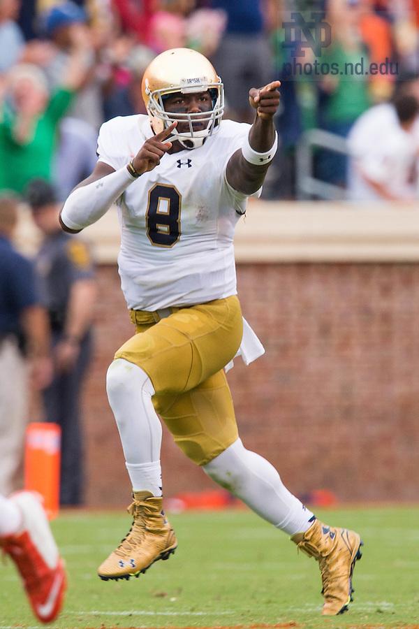 Sep 12, 2015; Irish quarterback Malik Zaire (8) celebrates after throwing a touchdown pass in the third quarter against Virginia. (Photo by Matt Cashore)