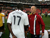USA's Head coach Bob Bradley congratulates Jozy Altidore after the match between the national teams of South Africa (RSA) and the United States (USA) in an international friendly dubbed the Nelson Mandela Challenge at Ellis Park Stadium in Johannesburg, South Africa on November 17, 2007. The United States defeated South Africa 1-0.