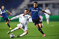 Nacho Fernandez of Real Madrid and Luis Muriel of Atalanta BC compete for the ball during the Champions League round of 16 football match between Atalanta BC and Real Madrid at Atleti azzurri d'Italia stadium in Bergamo (Italy), February, 24th, 2021. Photo Image Sport  / Insidefoto