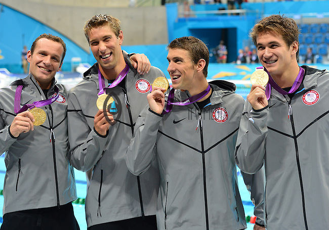 August 04, 2012..Brendan Hansen, Matt Grevers, Michael Phelps, Nathan Adrian pose with Gold Medal at the conclusion of 4x100m Medley Relay at the Aquatics Center on day eight of 2012 Olympic Games in London, United Kingdom.
