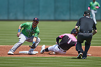 Yolmer Sanchez (2) of the Gwinnett Stripers waits for a throw as Matt Reynolds (1) of the Charlotte Knights slides into second base as umpire Clint Vondrak looks on at Truist Field on May 9, 2021 in Charlotte, North Carolina. (Brian Westerholt/Four Seam Images)