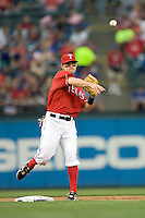 Texas Rangers second baseman Ian Kinsler (5) throws the ball to first against the Oakland Athetics in American League baseball on May 11, 2011 at the Rangers Ballpark in  Arlington, Texas. (Photo by Andrew Woolley / Four Seam Images)