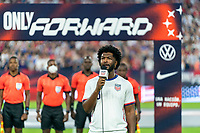 NASHVILLE, TN - SEPTEMBER 5: A performer sings the national anthem during a game between Canada and USMNT at Nissan Stadium on September 5, 2021 in Nashville, Tennessee.