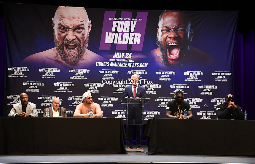 """LOS ANGELES, CA - JUNE 15: (L-R) Sugarhill Steward, Bob Arum, Tyson Fury, Jimmy Lennon Jr, Deontay Wilder, and Malik Scott attend a press conference for the FOX Sports PPV """"Tyson Fury vs. Deontay Wilder III"""" at The Novo by Microsoft at LA Live on June 15, 2021 in Los Angeles, California. Fury vs. Wilder will be on July 24 at the T-Mobile Arena in Las Vegas. (Photo by Frank Micelotta/HULU/PictureGroup)"""