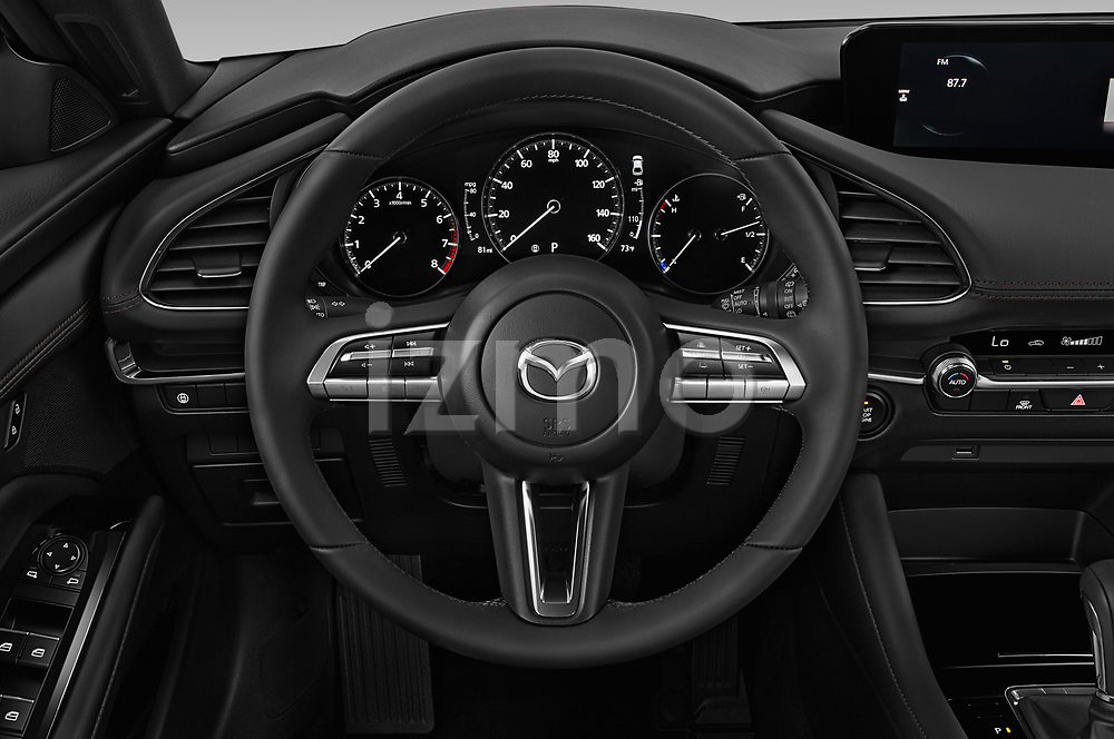 Car pictures of steering wheel view of a 2019 Mazda Mazda-3 - 5 Door Hatchback Steering Wheel