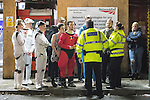 © Joel Goodman - 07973 332324 . 27/12/2016 . Wigan , UK . Police speak to people dressed as Storm Troopers and other costumes . Revellers in Wigan enjoy Boxing Day drinks and clubbing in Wigan Wallgate . In recent years a tradition has been established in which people go out wearing fancy-dress costumes on Boxing Day night . Photo credit : Joel Goodman