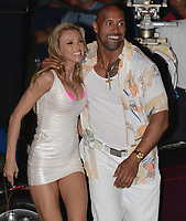 """MIAMI  BEACH, FL - APRIL 25: (EXCLUSIVE COVERAGE)  Israli super-model Bar Paly and Dwayne """"The Rock"""" Johnson film a scene together in a purple Chrysler Prowler, on the set of Pain and Gain which is directed by Michael Bay. Pain and Gain is about a  pair of bodybuilders in Florida get caught up in an extortion ring and a kidnapping scheme that goes terribly wrong. on April 25, 2012 in Miami Beach, Florida<br /> <br /> <br /> People:  Bar Paley_Dwayne Johnson"""