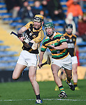 Niall Deasy of Ballyea in action against Brian Moylan of Glen Rovers during their Munster Club hurling final at Thurles. Photograph by John Kelly.