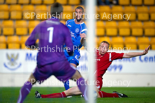 St Johnstone v Morton..24.08.10  CIS Cup Round 2.Marcus Haber's shot is blocked by Stuart Greacen.Picture by Graeme Hart..Copyright Perthshire Picture Agency.Tel: 01738 623350  Mobile: 07990 594431