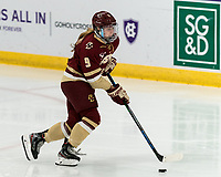 WORCESTER, MA - JANUARY 16: Maddie Crowley-Cahill #9 of Boston College brings the puck forward during a game between Boston College and Holy Cross at Hart Center Rink on January 16, 2021 in Worcester, Massachusetts.
