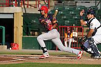 Peoria Chiefs Leobaldo Pina (4) swings during the Midwest League game against the Burlington Bees at Community Field on June 8, 2016 in Burlington, Iowa.  Burlington won 4-2.  (Dennis Hubbard/Four Seam Images)