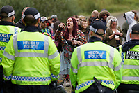 Pictured: A young woman protests against a line of police officers. Monday 31 August 2020<br /> Re: Around 70 South Wales Police officers executed a dispersal order at the site of an illegal rave party, where they confiscated sound gear used by the organisers in woods near the village of Banwen, in south Wales, UK.