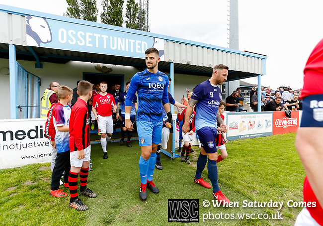 Yorkshire's Captain Tom Greaves leads his team onto the pitch. Yorkshire v Parishes of Jersey, CONIFA Heritage Cup, Ingfield Stadium, Ossett. Yorkshire's first competitive game. The Yorkshire International Football Association was formed in 2017 and accepted by CONIFA in 2018. Their first competative fixture saw them host Parishes of Jersey in the Heritage Cup at Ingfield stadium in Ossett. Yorkshire won 1-0 with a 93 minute goal in front of 521 people. Photo by Paul Thompson