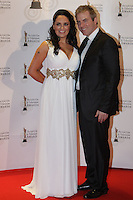 12/2/11 Donal McIntyre and wife Ameera on the red carpet at the 8th Irish Film and Television Awards at the Convention centre in Dublin. Picture:Arthur Carron/Collins