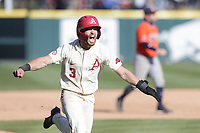 Arkansas Zack Gregory (3) runs home to win the game, Saturday, April 3, 2021 during the tenth inning of a baseball game at Baum-Walker Stadium in Fayetteville. Check out nwaonline.com/210404Daily/ for today's photo gallery. <br /> (NWA Democrat-Gazette/Charlie Kaijo)