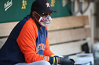 OAKLAND, CA - SEPTEMBER 25:  Manager Dusty Baker Jr. #12 of the Houston Astros sits in the dugout during the game against the Oakland Athletics at the Oakland Coliseum on Saturday, September 25, 2021 in Oakland, California. (Photo by Brad Mangin)