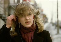 Montreal (Qc) CANADA - File photo taken between 1983 and 1989  - Girl listening to music on a walkman (tm)<br />  - PHOTO D'ARCHIVE :  Agence Quebec Presse