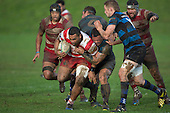 Siulongoua Fotofili tries to break free from Robert Katu's tackle. Counties Manukau Premier Club Rugby game between Karaka and Onewhero, played at Karaka on Saturday June 25th 2016. Karaka won the game 15 - 10 after leading 10 - 3 at halftime.<br />  Photo by Richard Sprnger.