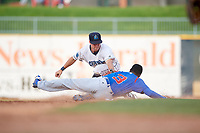 Lake County Captains shortstop Ernie Clement (31) puts a tag on Chris Singleton (3) during the first game of a doubleheader against the South Bend Cubs on May 16, 2018 at Classic Park in Eastlake, Ohio.  South Bend defeated Lake County 6-4 in twelve innings.  (Mike Janes/Four Seam Images)