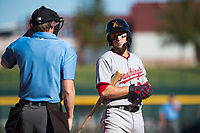 Salt River Rafters shortstop Carter Kieboom (24), of the Washington Nationals organization, discusses a called strike three with home plate umpire Alex Tosi during an Arizona Fall League game against the Mesa Solar Sox at Sloan Park on November 9, 2018 in Mesa, Arizona. Mesa defeated Salt River 5-4. (Zachary Lucy/Four Seam Images)
