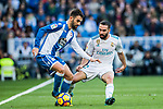 Adrian Lopez Alvarez (L) of RC Deportivo La Coruna battles for the ball with Daniel Carvajal Ramos of Real Madrid during the La Liga 2017-18 match between Real Madrid and RC Deportivo La Coruna at Santiago Bernabeu Stadium on January 21 2018 in Madrid, Spain. Photo by Diego Gonzalez / Power Sport Images