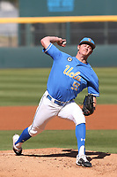 Jesse Bergin (55) of the UCLA Bruins pitches against the Cal State Fullerton Titans at Jackie Robinson Stadium on March 6, 2021 in Los Angeles, California. UCLA defeated Cal State Fullerton, 6-1. (Larry Goren/Four Seam Images)