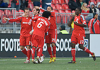 17 October 2009: Toronto FC forward Chad Barrett #19,Toronto FC midfielder Dewayne DeRosario #14,Toronto FC midfielder Julian de Guzman #6 and Toronto FC forward O'Brian White #17 celebrate Toronto FC midfielder Jim Brennan's goal in the first half during an MLS game between Real Salt Lake and Toronto FC at BMO Field in Toronto..Toronto FC won 1-0. .