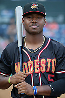 Kyle Lewis (5) of the Modesto Nuts poses for a photo before a game against the Rancho Cucamonga Quakes at LoanMart Field on August 1, 2017 in Rancho Cucamonga, California. Rancho Cucamonga defeated Modesto, 2-1. (Larry Goren/Four Seam Images)