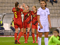 Tine De Caigny (6) of Belgium pictured celebrating with teammates Tessa Wullaert (9) of Belgium and Janice Cayman (11) of Belgium after scoring a goal during a female soccer game between the national teams of Belgium , called the Red Flames and Albania in the second game in the qualification for the  FIFA Women's World Cup in group F , on tuesday 21 st of September 2021  in Brussels , Belgium . PHOTO SPORTPIX