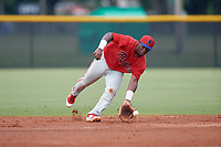 GCL Phillies East shortstop Wilfredo Flores (2) fields a ground ball during a Gulf Coast League game against the GCL Yankees East on July 31, 2019 at Yankees Minor League Complex in Tampa, Florida.  GCL Phillies East defeated the GCL Yankees East 4-3 in the second game of a doubleheader.  (Mike Janes/Four Seam Images)