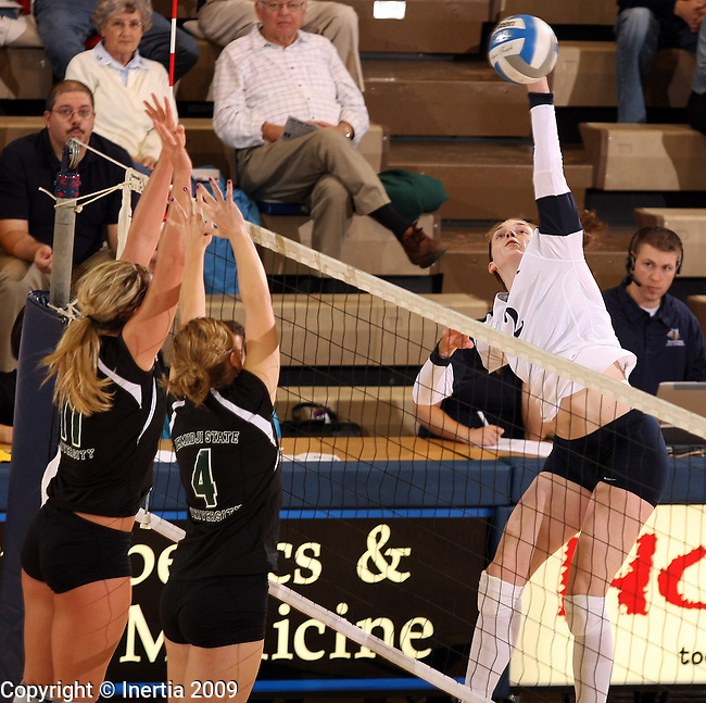 SIOUX FALLS, SD - NOVEMBER 6: Ellen Andrews #2 of Augustana tries to get a kill past Laura Carlson #11 and Laura Slinger #4 of Bemidji State in the second game of their match Friday night at the Elmen Center. (Photo by Dave Eggen/Inertia)