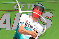 23rd April 2021; Cycling Tour des Alpes Stage 5, Valle del Chiese to Riva del Garda,  Italy on 23rd; Felix Grossschartner Bora-Hansgrohe wins stage 5 and celebrates on the podium