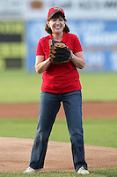 Congresswoman Kathy Hochul gets ready to throw to out the ceremonial first pitch before the first ever Triple-A International League game at Dwyer Stadium on April 20, 2012 in Batavia, New York.  Empire State defeated Norfolk 6-4.  (Mike Janes/Four Seam Images)
