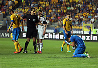 Thursday 29 August 2013<br /> Pictured: Match referee pulls Rory Donnelly of Swansea back (3rd L) after a minor injury suffered by Mircea Bonescu (R) goalkeeper for Petrolul Ploiesti<br /> Re: Petrolul Ploiesti v Swansea City FC UEFA Europa League, play off round, 2nd leg, Ploiesti, Romania.