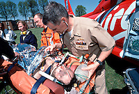 Military doctor examines a casualty saved from a house fire earlier, in need of urgent treatment for smoke inhalation, been brought to the military establishment by the HEMS helicopter for treatment in a hyperbaric chamber. This image may only be used to portray the subject in a positive manner..©shoutpictures.com..john@shoutpictures.com