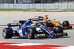 Sauber driver Marcus Ericsson (9) of Sweden and Stoffel Vandoome of Belguim (2) in action during the final practice before the Formula 1 United States Grand Prix race at the Circuit of the Americas race track in Austin,Texas.