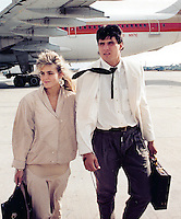 Jose Canseco of the Oakland Athletics, right, and his wife Esther walk on the tarmac after arriving at Los Angeles International Airport in Los Angeles for a World Series game against the Los Angeles Dodgers in October of 1988. Canseco became the first player in Major League history to hit 40 home runs and steal 40 bases. Canseco was unanimously named the American League's MVP in 1988. (Photo by Alan Greth)