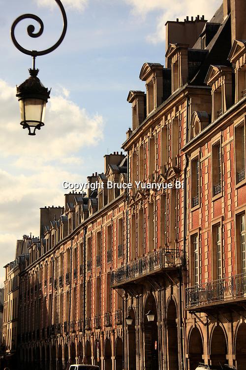 Brick and stone houses on Place des Vosges. Marais district. City of Paris. Paris. France