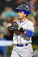 St. Lucie Mets catcher Albert Cordero (10) walks out to warm up the pitcher in between innings during a game against the Fort Myers Miracle on April 18, 2014 at Hammond Stadium in Fort Myers, Florida.  St. Lucie defeated Fort Myers 15-9.  (Mike Janes/Four Seam Images)