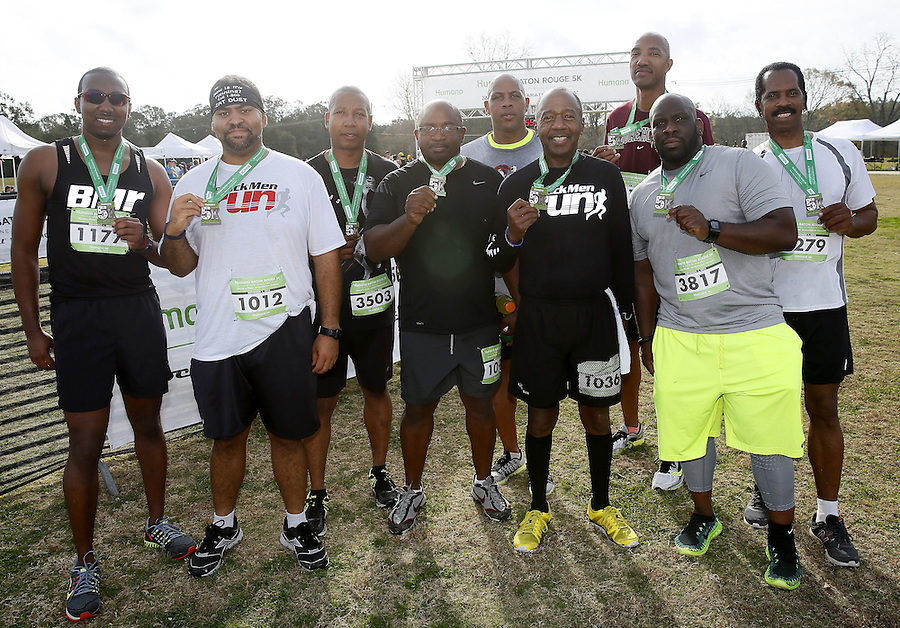 Participants celebrate with their medals after completing the Humana Rock 'n' Roll Baton Rouge 5K, on Saturday, Dec. 12, 2014 in Baton Rouge, La. (Jonathan Bachman/AP Images for Humana)