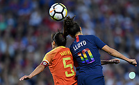 Cleveland, Ohio - Tuesday June 12, 2018: Wu Haiyan, Carli Lloyd during an international friendly match between the women's national teams of the United States (USA) and China PR (CHN) at FirstEnergy Stadium.