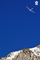 Glider flying over snowy mountain, French Alps, France (Licence this image exclusively with Getty: http://www.gettyimages.com/detail/82406553 )