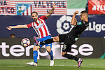 Juanfran of Atletico de Madrid competes for the ball with Andreas Pereira of Granada CF during their La Liga match between Atletico de Madrid and Granada CF at the Vicente Calderon Stadium on 15 October 2016 in Madrid, Spain. Photo by Diego Gonzalez Souto / Power Sport Images