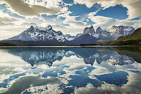 The Cuernos and Torres del Paine reflected in Lago Pehoé inside the Torres del Paine national park, Puerto Natales, Patagonia, Chile