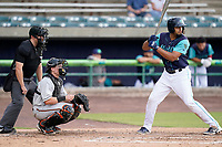 Right fielder Johnathan Rodriguez (32) of the Lynchburg Hillcats in a game against the Delmarva Shorebirds on Wednesday, August 11, 2021, at Bank of the James Stadium in Lynchburg, Virginia. The catcher is Logan Michaels (10) and the umpire is Ethan Gorsak. (Tom Priddy/Four Seam Images)