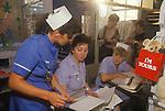 Staff nurse in blue, Alder Hey Hospital Manchester NHS Childrens Ward. 1980s 1988